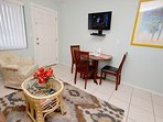 Wall mounted TV and dining table