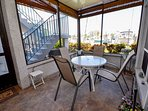 Screened patio with view of the water