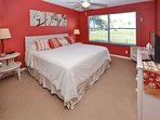 Master bedroom with king size bed, flat screen TV and adjoining bath