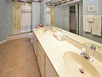 Master bath with large soaking tub with shower & double vanity