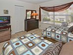 Guest Bedroom with twin beds & flat screen TV