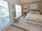 Bedroom with Queen Bed & Large Windows