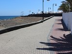 Promenade leads to Arrecife (left) and Puerto del Carmen (right). Restaurants just 5 to 10 mins.