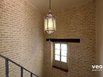The house combines modern elements with traditional features such as exposed brick walls.
