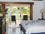 Master bedroom with beautiful view of the beach & pool