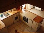 Open plan kitchen with utilities