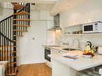 Fully fitted kitchen with hob, grill, microwave, washer/dryer.