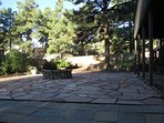 The large fenced backyard with Flagstone patio and fire pit. Corn hole, anybody?