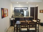 Large modern full kitchen with room for family dining.
