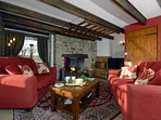 Solva holiday cottage - cosy lounge with log burning fire and dogs welcome