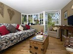 Pembrokeshire Coast National Park holiday cottage - sitting room with French doors to the patio