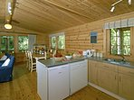 Self-catering log cabin near Newport - open plan fitted kitchen
