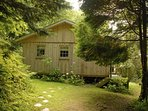 Pet friendly Cwm yr Eglwys, Pembrokeshire  - log cabin  with private gardens