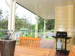 Unit 1's front verandah has a beautiful garden surrounding it.