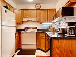 The kitchen w/ upgraded appliances