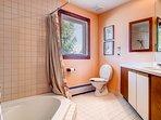 The master bathroom w/ large sunken hot tub