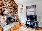 Living Room w/ stone fireplace and flat screen Tv