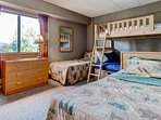 Bedroom 2 has 2 single beds and a bunk bed