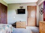 Bedroom 2 has a flat screen TV