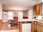 Kitchen w/ dated appliances