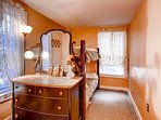 Lower bedroom w/ vanity dresser