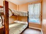 Lower bedroom w/ bunk beds