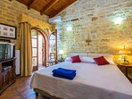 Bedroom with double bed, upstairs in the studio of our Villa