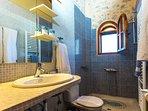 Bathroom with shower that is en suite to the bedroom of the studio