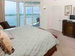 King master bedroom with lagoon views and private balcony access