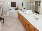 Tiled master bath with dual vanities
