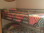 Bright and funky bedroom with bunk beds - the children will argue over the top bunk!