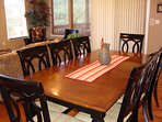 Dining for 15 with seating at island and table on deck or folding table.