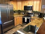 100% Stainless steel appliances, granite, and custom lighting.