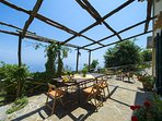 Outdoor terrace with ocean view and patio relax at villa terralu with shared pool and garden service