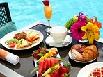 Pool side breakfast at the villa