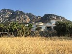 sweeping views out across the sea from the villa and stunning mountains behind