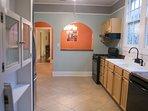 Large spacious kitchen with dishwasher, stove & large fridge.