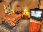 Queen Bedroom - Second level queen bedroom with a TV.