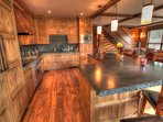 Gourmet Kitchen - The wood throughout the home is brilliant and gives a great mountain home feel.
