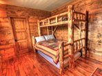 Bunk Room - This bedroom features a bunk bed with a queen size bed on the bottom and a twin size on the top.