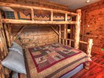Bunk Room - The bunk room has a custom hand made log bed.