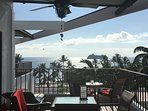 Enjoy a drink or dinner view from covered lanai with ceiling fan.