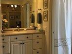Quest bath dressing area adjacent to full bath in quest suite