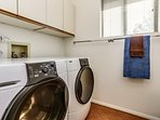 Laundry with washer and dryer, plus detergent supplied.