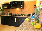 The kitchen is equipped with all new appliances and everything for cooking meals.
