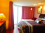1 queen bed and 1 single bed with enclosed lanai