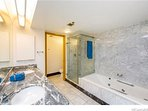 Jacuzzi bath tub with separate shower room. Specious marble bathroom.