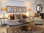 Comfy living area with sleeper sofa for additional sleeping.