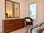 Enjoy a partial gulf view from the guest bedroom.