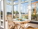 Shelter in the sunny conservatory - leads onto patio garden